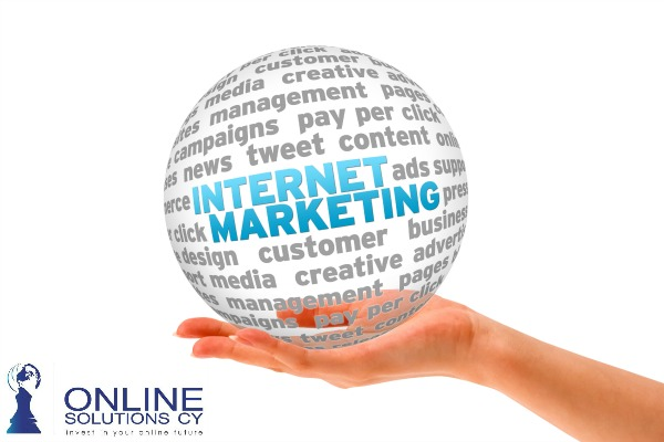 Hand holding a Internet Marketing 3d Sphere.